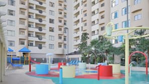 Outdoor pool, open 8:00 AM to 6:00 PM, pool umbrellas