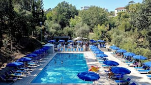 Outdoor pool, open 9:30 AM to 6:30 PM, pool umbrellas, pool loungers