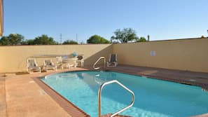 Outdoor pool, open 2:00 PM to 9:00 AM, sun loungers