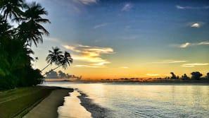 Beach nearby, white sand, beach shuttle, sun loungers