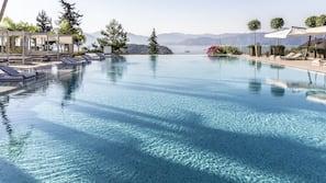 Indoor pool, outdoor pool, free pool cabanas, pool loungers