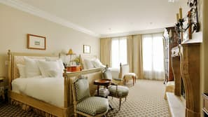 Premium bedding, down comforters, free minibar items, in-room safe