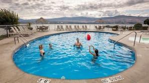 Seasonal outdoor pool, open 9:00 AM to 10:00 AM, pool umbrellas