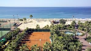 On the beach, beach shuttle, beach cabanas, sun-loungers