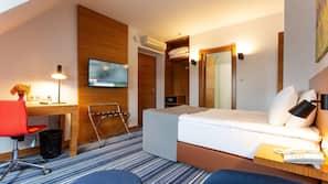 Luxe beddengoed, pillowtop-bedden, een kluis op de kamer