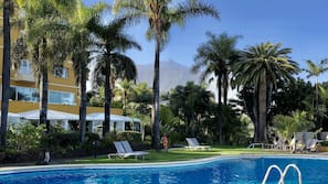 Outdoor pool, open 7:00 AM to 7:30 PM, pool umbrellas, sun loungers