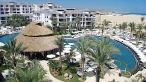 6 outdoor pools, free pool cabanas, pool umbrellas