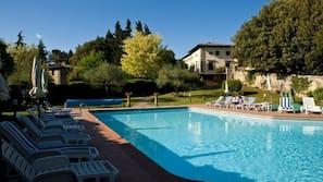 Seasonal outdoor pool, open 7 AM to 8:30 PM, pool umbrellas