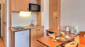 Fridge, microwave, cookware/dishes/utensils