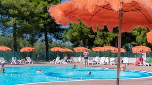 2 outdoor pools, open 9 AM to 7:00 PM, pool umbrellas, pool loungers