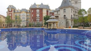 Outdoor pool, open 7:30 AM to 11 PM, pool loungers