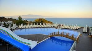 Seasonal outdoor pool, open 7:30 AM to 7:30 PM, pool umbrellas