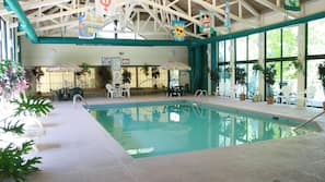 Indoor pool, open 10:00 AM to 10:00 PM, pool loungers