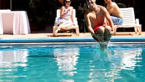Outdoor pool, open 8:00 AM to 8:00 PM, sun loungers