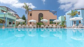 2 outdoor pools, open 9 AM to 6 PM, pool umbrellas, pool loungers