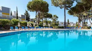 3 outdoor pools, open 9:00 AM to 8:00 PM, pool umbrellas, pool loungers
