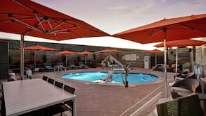 Outdoor pool, open 8:00 AM to 10:00 PM, free cabanas, pool umbrellas