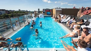 Outdoor pool, open noon to 9:00 PM, sun loungers