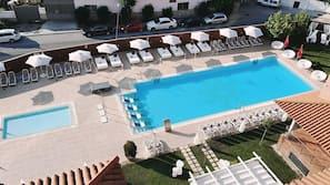 Seasonal outdoor pool, open 11:00 AM to 8:30 PM, pool umbrellas