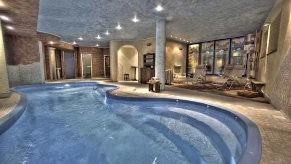 Indoor pool, open 2:00 PM to 8:00 PM, pool loungers