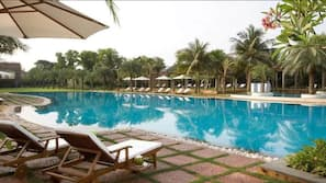 Outdoor pool, open 6 AM to 11:00 PM, pool umbrellas