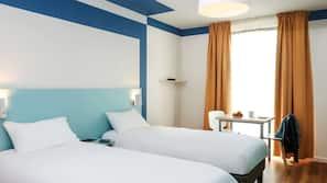 Coffres-forts dans les chambres, fer et planche à repasser