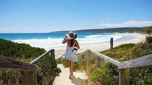 On the beach, white sand, surfing