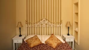 Premium bedding, down duvets, individually decorated