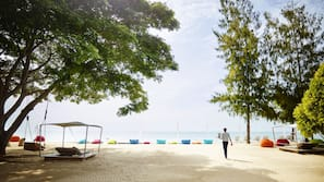 Private beach, free beach cabanas, beach shuttle, sun loungers