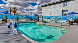 Outdoor pool, open 9:00 AM to 9:00 PM, free cabanas, pool umbrellas