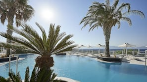 3 outdoor pools, open 10:00 AM to 6:00 PM, pool umbrellas, sun loungers