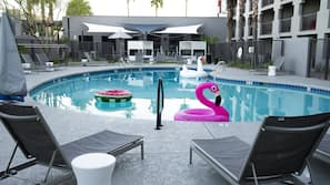 Outdoor pool, open 7:00 AM to 11:00 PM, free cabanas, sun loungers