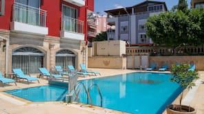 Indoor pool, outdoor pool, open 9 AM to 10 PM, pool umbrellas