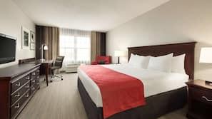 Roupas de cama premium, escrivaninha, cortinas blackout