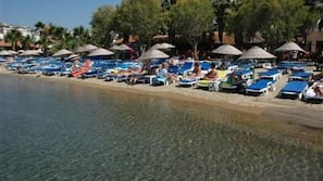 Private beach, sun loungers, beach umbrellas, water skiing