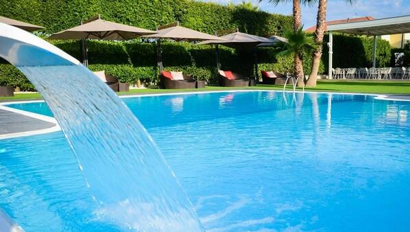Seasonal outdoor pool, open 9:30 AM to 6:30 PM, pool umbrellas