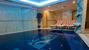Indoor pool, open noon to 10:00 PM, pool loungers