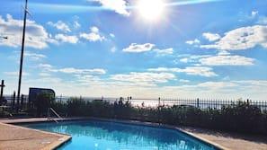 Seasonal outdoor pool, open 11:00 AM to 10:00 PM, pool umbrellas