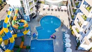 Seasonal outdoor pool, open 9:30 AM to 6:00 PM, pool umbrellas