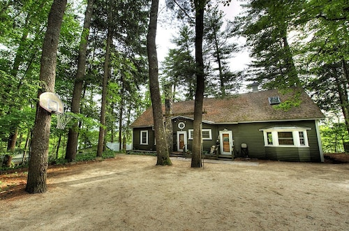 Stunning Forest Lakefront Home- Hot Tub, Boats, Bikes, For Fun, Inquire Today!
