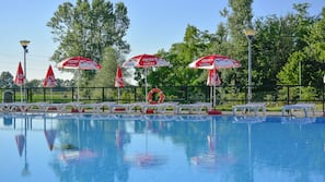 2 outdoor pools, open 10 AM to 7 PM, pool umbrellas, sun loungers