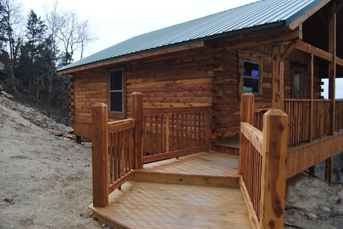 Great Place to stay Can-u-canoe 109 The Trout House Mountain Top Cabin near Eureka Springs