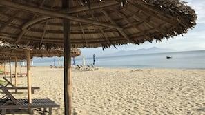 On the beach, white sand, beach massages