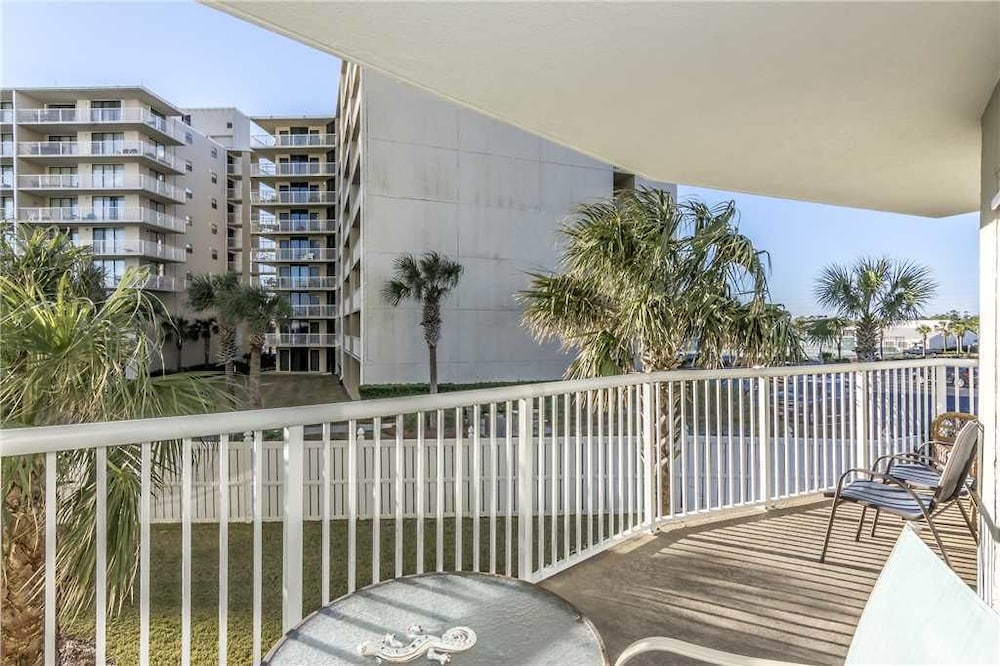 Balcony, Tradewinds 108 - 1 Br condo by RedAwning