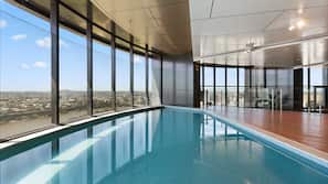 Indoor pool, open 6 AM to 10 PM, pool loungers