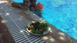 Seasonal outdoor pool, open 10 AM to 10 PM, pool umbrellas, sun loungers