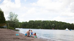 On the beach, sun loungers, beach towels, beach volleyball