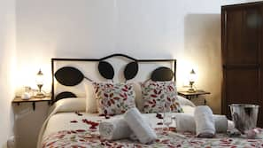 1 bedroom, premium bedding, down comforters, blackout drapes