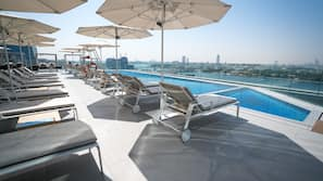 Outdoor pool, open 8:00 AM to 10:00 PM, free pool cabanas