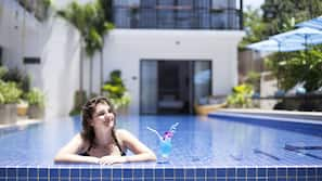 Outdoor pool, open 7 AM to 9 AM, pool umbrellas, pool loungers